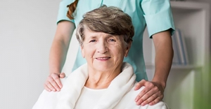 A happy patient at a senior care facility.